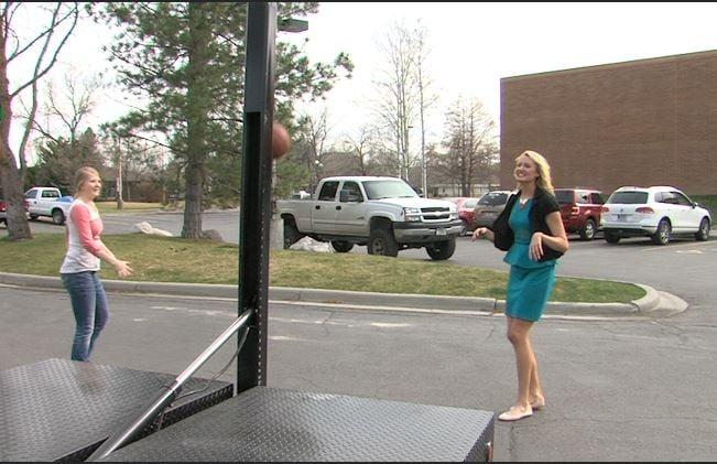 KULR-8's Melinda Lee enjoys a work break with some 1-on-1 on Annie Cook's truck hoop