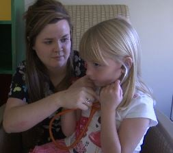 St. Vincent Healthcare pediatric nurse Brittany Gonzales and 5-year-old patient, Kate Jordan