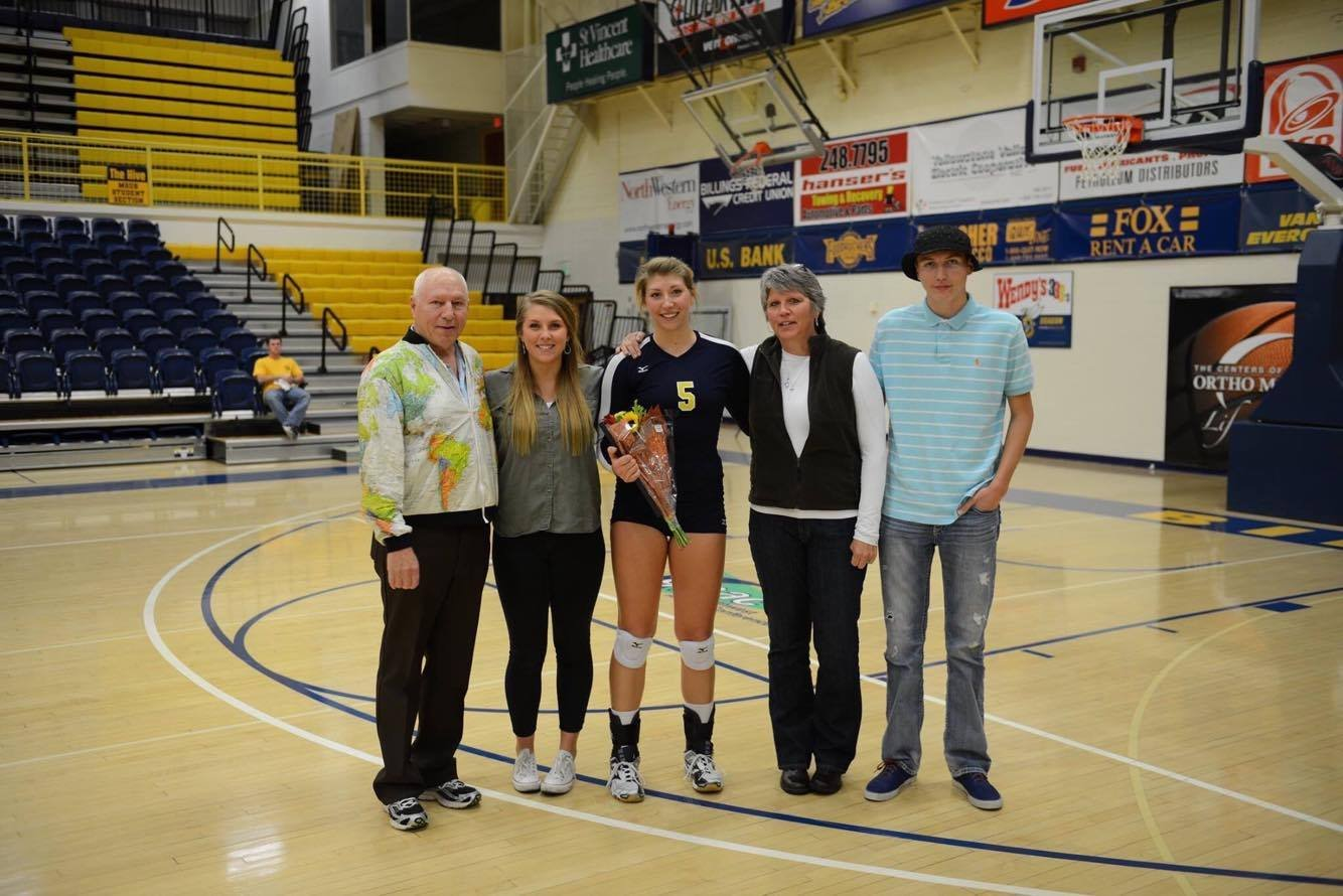 Chelsey Walter poses with her Billings family during MSUB Volleyball's Senior night