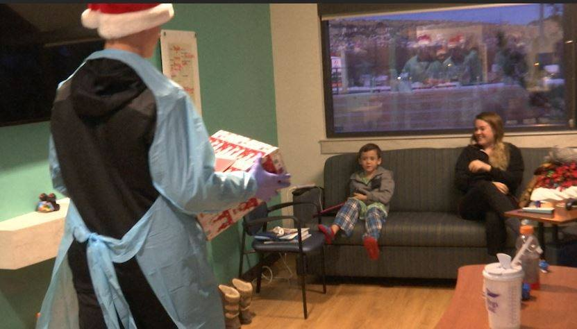 The Billings West Boys Basketball team delivers Christmas presents to local pediatric patients spending the holiday in the hospital