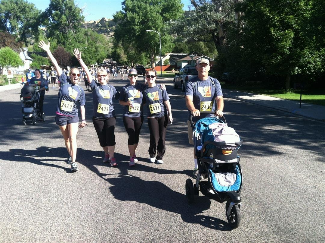 Dr. Gary Ostahowski, his wife Vera, and three daughters taking part in the Heart and Sole Run in Billings