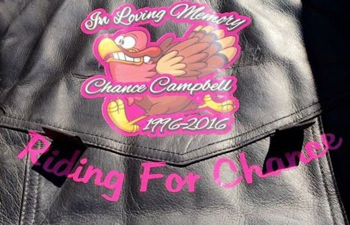 "While riding bulls, Kenna Hazen wears ""Riding For Chance"" attire to honor of the memory of her friend Chance Campbell"