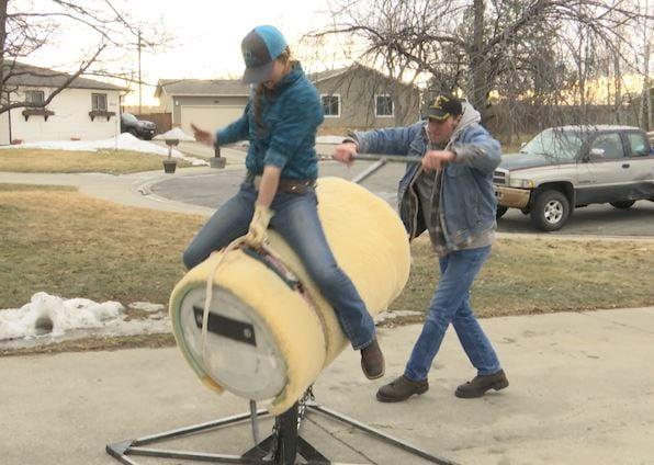 "Kenna Hazen uses a homemade ""bull"" to practice bull riding"