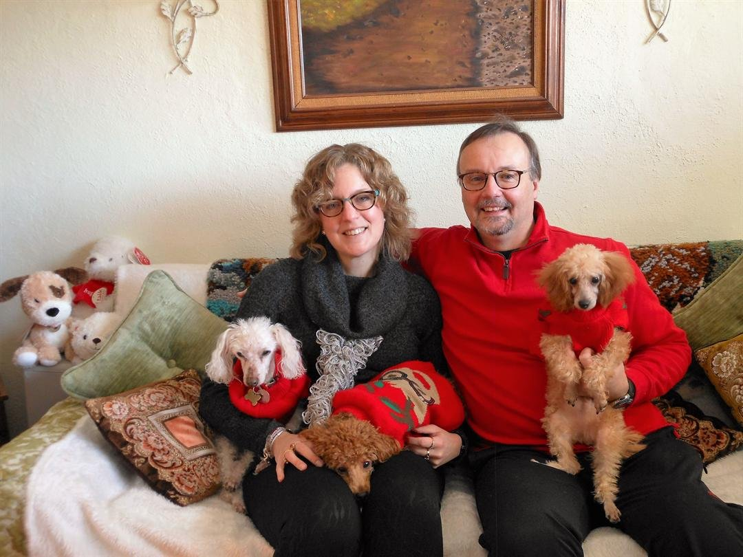 Robyn and Bob Cummings with dogs Farley (far left), Percy (middle), and Jimmy. (far right)
