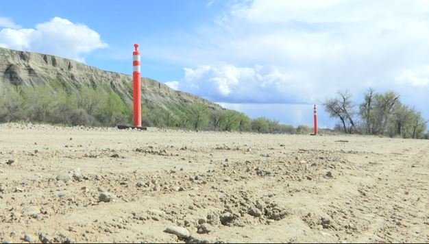 Cones indicate where the Big Horn River is wearing away the banks and roads in Hardin