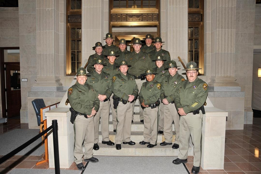 L to R Row 1: Colonel Kebin Haller, Lieutenant Colonel Shannon Ratliff L to R Row 2: Troopers Eric Spring, Caleb Massie, Patrick Maez, Samuel Szott L to R Row 3: Troopers Jeffrey McMillen, Clint Christensen, Amber Huschka L to R Row 4: Sergeant Randy Star