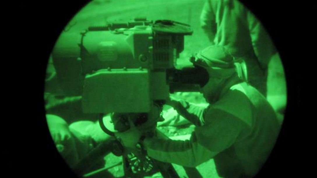 Army Sgt. Mihail Golin uses a tube-launched, optically tracked, wire-guided missile to help in securing the Afghanistan and Pakistan border crossing of Chergotah in the Terezayi district of Afghanistan's Khost province, Dec. 4, 2009. U.S. Air Force photo