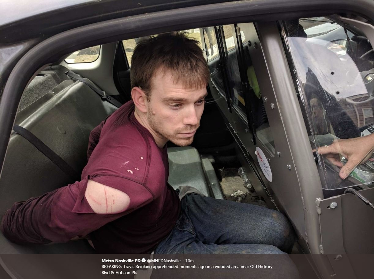 (Photo courtesy: Twitter@MNPDNashville) Photo shows Travis Reinking, suspect in Waffle House shooting, being apprehended.