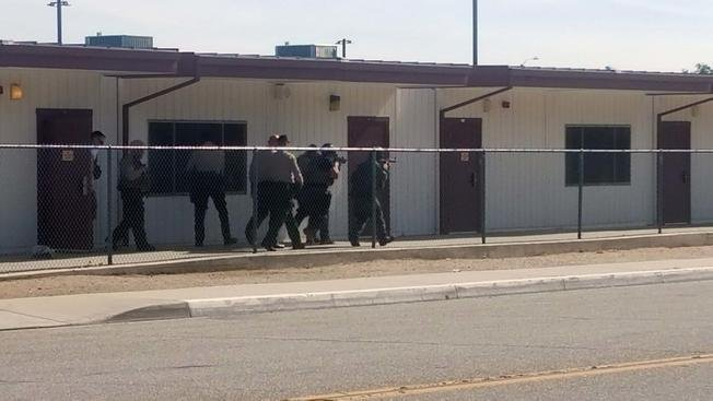 Deputies are pictured at Highland High School after a report of gunfire Friday May 11, 2018 on the Palmdale campus north of Los Angeles.