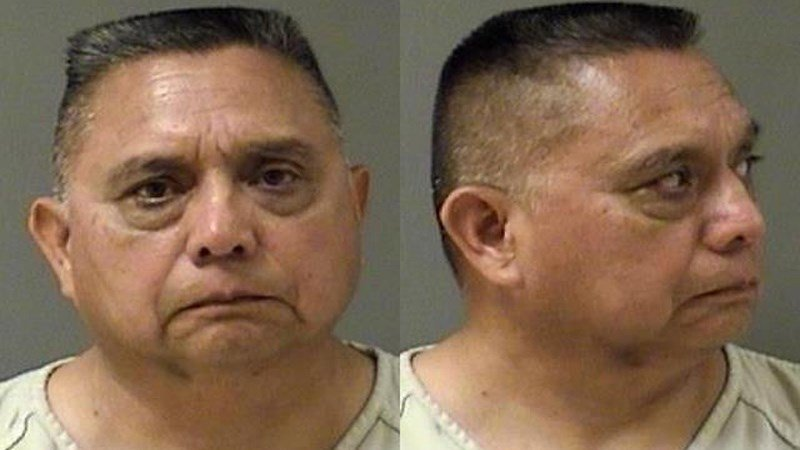 Jose Cobos, 62, is charged with negligent homicide in the shooting death of his neighbor, Mark Joseph Kirby, 52.